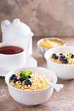 Cooked millet porridge with lemon curd and blueberry Royalty Free Stock Images