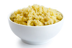 Cooked millet in white ceramic bowl. Stock Photo