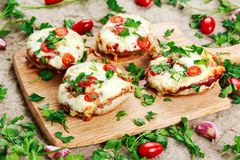 Cooked Mushrooms stuffed with cheese and plum tomatoes Royalty Free Stock Image