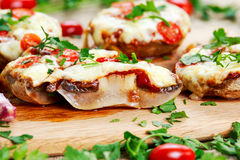Cooked Mushrooms stuffed with cheese and plum tomatoes Royalty Free Stock Photo