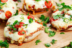 Cooked Mushrooms stuffed with cheese and plum tomatoes Stock Photos