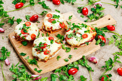Cooked Mushrooms stuffed with cheese and plum tomatoes Royalty Free Stock Images