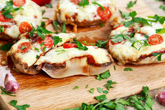 Cooked Mushrooms stuffed with cheese and plum tomatoes Royalty Free Stock Photography