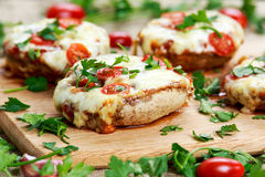 Cooked Mushrooms stuffed with cheese and plum tomatoes Stock Photography