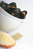 Cooked mussels. Bowl of mussels with bread stock photo
