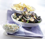 Cooked mussels served in a bowl with sauce Stock Photos