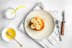 Cooked pancake on plate top view at wooden background Stock Image