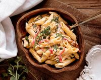 Cooked Pasta on Brown Wooden Bowl Stock Photo