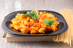 Cooked pasta girandole on a black plate Stock Photography