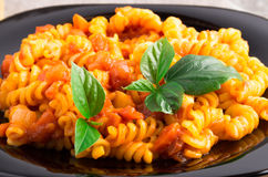 Cooked pasta girandole with herbs close-up Stock Images
