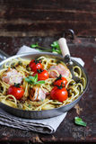 Cooked pasta spaghetti with bacon and roasted cherry tomatoes Royalty Free Stock Photography