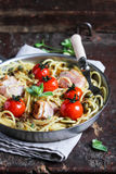 Cooked pasta spaghetti with bacon and roasted cherry tomatoes Stock Image