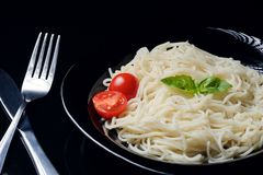 Cooked pasta in the steel plate. royalty free stock photo