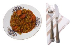 Cooked peas with bacon on plate Stock Photos