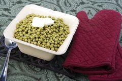 Cooked peas with butter in a ceramic dish Royalty Free Stock Photography