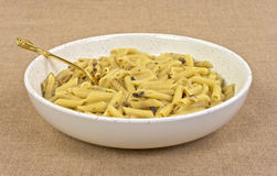 Cooked penne pasta with mushrooms in bowl Stock Images