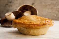 Cooked Pie and a Pair of Mushrooms stock photography