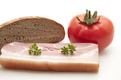 Cooked pig meat with tomato Stock Images