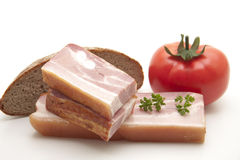 Cooked pig meat with tomato Royalty Free Stock Images