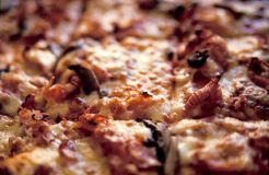 Cooked pizza detail Stock Photography