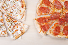 Cooked pizza on thin crust in the kitchen. Thin pizza cooked in the kitchen home Stock Photos