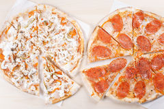 Cooked pizza on thin crust in the kitchen. Thin pizza cooked in the kitchen home Stock Image