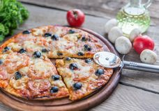 Cooked pizza on the wooden board Royalty Free Stock Photo