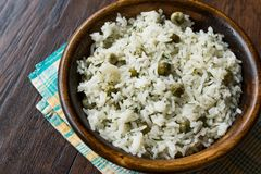 Cooked Plain Basmati Rice with Dill and Green Peas / Pilav or Pilaf in Wooden Bowl. Royalty Free Stock Images