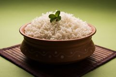 Cooked plain white basmati rice in terracotta bowl, selective focus royalty free stock photos