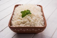 Cooked plain white basmati rice in terracotta bowl, selective focus royalty free stock image