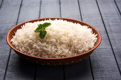 Cooked plain white basmati rice in terracotta bowl, selective focus. Cooked plain white basmati rice in terracotta bowl over plain or wooden background stock photography