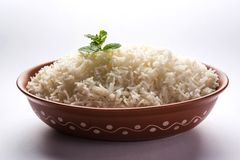 Cooked plain white basmati rice in terracotta bowl, selective focus royalty free stock images