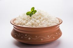 Cooked plain white basmati rice in terracotta bowl, selective focus stock image