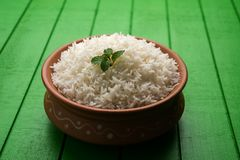 Cooked plain white basmati rice in terracotta bowl, selective focus stock images