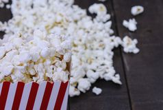 Cooked pop corn in striped paper box Stock Photo