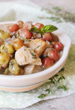 Cooked pork with onion, garlic, red grape in white wine Stock Photos