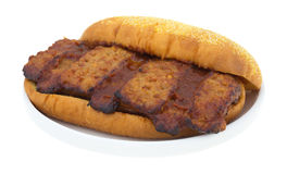 Cooked pork rib sandwich in bun on a plate Stock Photo