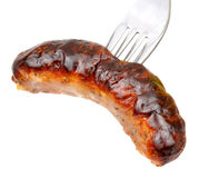 Cooked Pork Sausage And Fork Royalty Free Stock Image