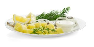 Cooked potatoes with a herring Royalty Free Stock Photos