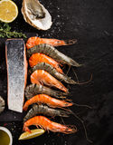 Cooked prawns on black stone Stock Images