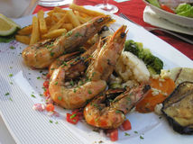 Cooked prawns in the restaurant Stock Images