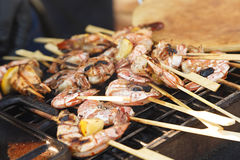Cooked prawns on skewers Stock Photos
