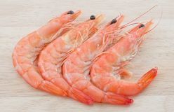 Cooked Prawns or Tiger Shrimps on A Cutting Board. Cuisine and Food, Cooked Prawns or Tiger Shrimps on A Wooden Cutting Board Royalty Free Stock Photography
