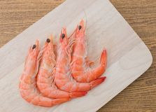 Cooked Prawns or Tiger Shrimps on Cutting Board. Cuisine and Food, Cooked Prawns or Tiger Shrimps on Wooden Cutting Board Royalty Free Stock Image