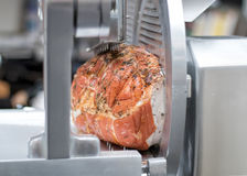 Cooked Prosciutto Cotto Ham With Herbs. Gourmet Meat Deli, Meat Slicer. Royalty Free Stock Photography