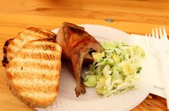 Cooked quail with salad Stock Photos