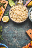 Cooked quinoa in aged rustic cooking pot on kitchen table, top view, place for text. Superfood Stock Photography