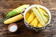Cooked and raw corncobs Stock Image