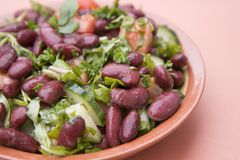 Cooked red beans plate on pink background, isolated. Healthy food. Cooked red beans plate on pink background, isolated stock image