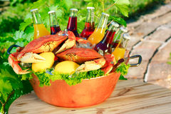 Cooked Red Dungeness Crabs, Lemon, Soft Drinks. Cooked Red Dungeness Crabs In Copper Bucket With Assorted Flavored Sodas, Orange, Cranberry, Lemon, Berry Royalty Free Stock Images